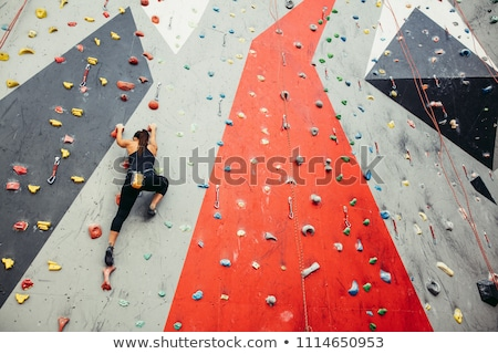 Low angle view female athlete climbing wall Stock photo © wavebreak_media