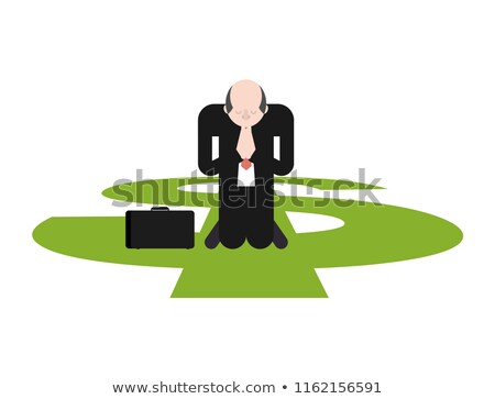 prayer for money businessman is praying on his knees to dollar stock photo © maryvalery