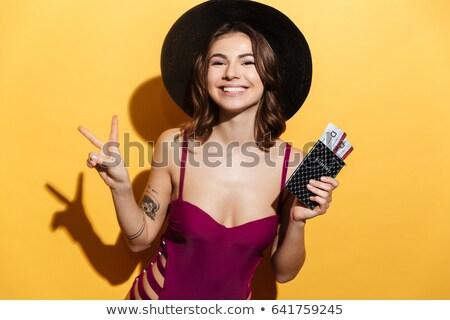 woman in swimsuit holding tickets stock photo © lightfieldstudios