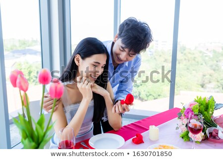 young asian man making a marriage proposal stock photo © rastudio