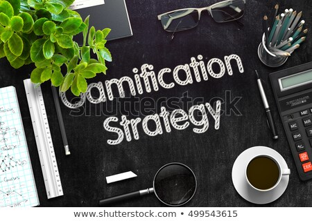 Gamification Strategy on Black Chalkboard. 3D Rendering. Stock photo © tashatuvango