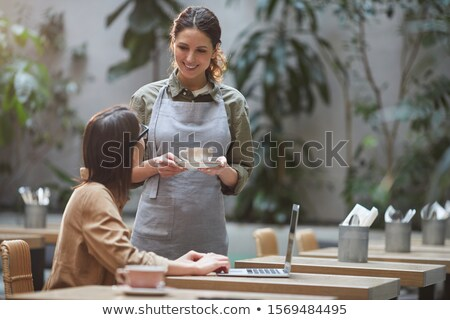 Female waitress bringing drinks Stock photo © IS2