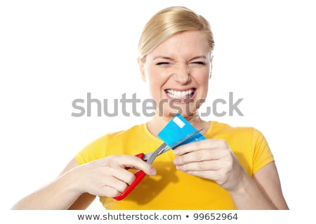 Woman cutting up her credit card stock photo © IS2