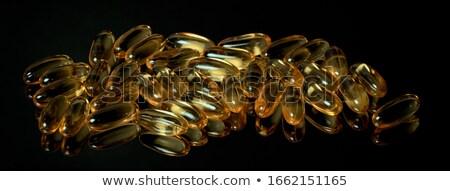 Amarelo médico cápsulas espelho superfície quadro Foto stock © Traimak