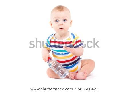 cute joyful baby boy in colorful shirt hold water bottle stock photo © Traimak