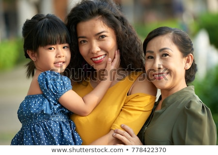 attractive family portrait walking outdoors stock photo © feverpitch