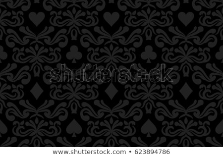 seamless black background with poker symbols surrounded by floral ornament pattern stock photo © liliwhite
