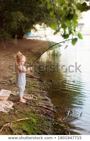 Girl holding fishing net & bucket Stock photo © IS2