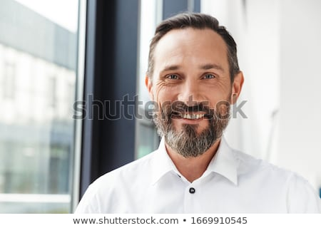 Portrait of a cheerful satisfied businessman Stock photo © deandrobot