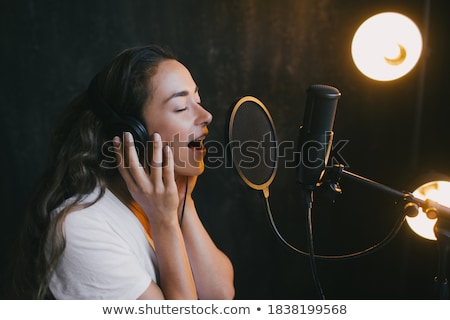 женщину · пения · микрофона · лице · Sexy - Сток-фото © keeweeboy