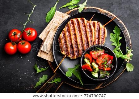 Lédús grillcsirke hús kebab friss zöldség saláta Stock fotó © yelenayemchuk