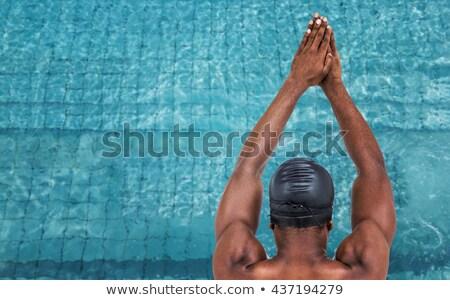 Vista posteriore nuotatore pronto immersione bianco formazione Foto d'archivio © wavebreak_media