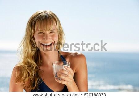 Сток-фото: Woman Drinking Glass Of Water On Beach