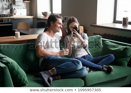 Teenage couple using a cellular telephone Stock photo © IS2