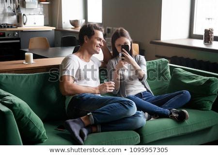 Jugendlich Paar zellulären Telefon Mädchen Junge Stock foto © IS2