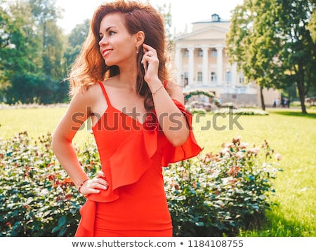 teenage girl standing against a tree stock photo © is2