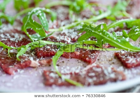carpaccio with sallad and parmesan cheese stock photo © phila54