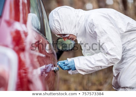 Stock photo: criminalist collecting evidence at crime scene