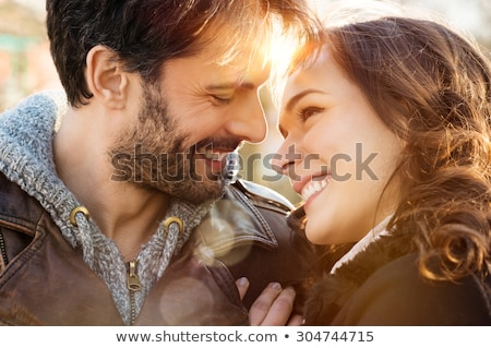 closeup portrait of a happy young couple looking at each other stock photo © konradbak