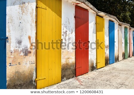 Several old wooden colorful doors on shabby light wall backgroun Stock photo © bezikus