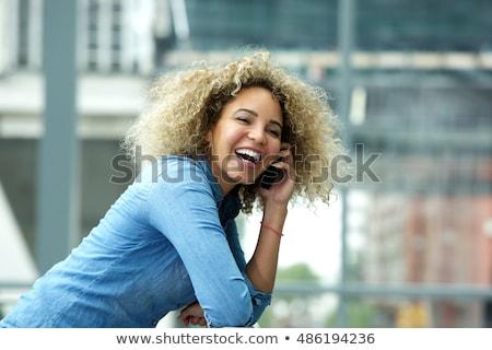 Risonho jovem senhora posando elegante colorido Foto stock © acidgrey