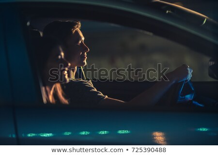 handsome pair driving at night stock photo © konradbak