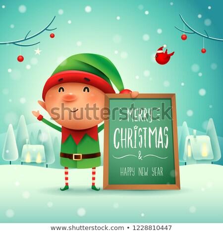 Merry Christmas! Little elf with message board in Christmas snow scene winter landscape. Stock photo © ori-artiste