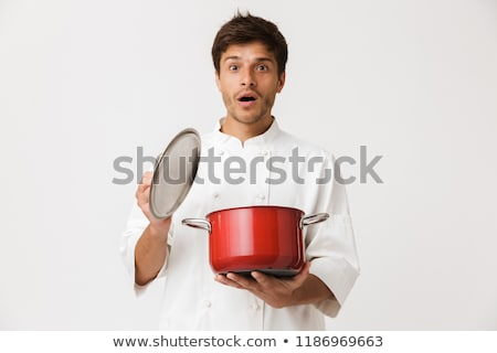 excited young chef man standing isolated over white wall background stock photo © deandrobot