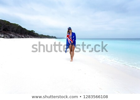 Vrouw australisch vlag rond strand taille Stockfoto © lovleah