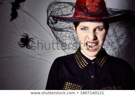 Attrattivo donna indossare nero costume halloween Foto d'archivio © deandrobot