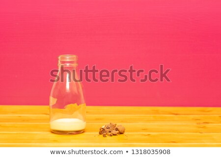 milk bottle half full of banana milkshake with cookie crumbs stock photo © sarahdoow