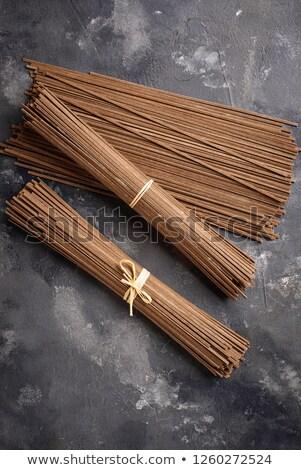 Raw uncooked Japanese soba noodles on grey bacground Stock photo © furmanphoto