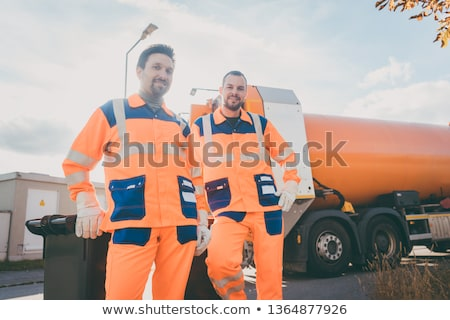 Two garbage removal service workers having short break Stok fotoğraf © Kzenon