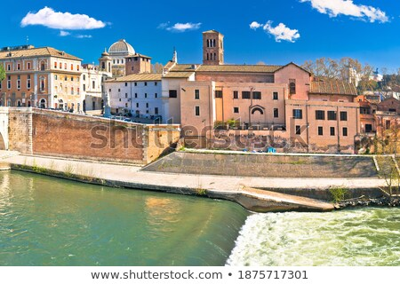 Tiber river island and Rome waterfront view Stock photo © xbrchx