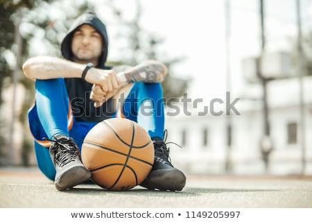 Séduisant homme noir séance tribunal cheveux bouclés Photo stock © boggy
