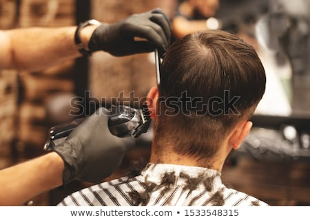 Barber Service, Man on Chair and Barbershop Master Stock photo © robuart