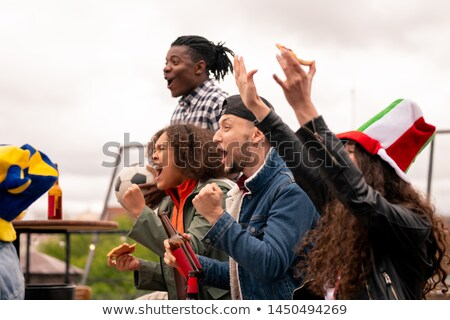 Ecstatic football fans expressing excitement after goal of their team Stock photo © pressmaster