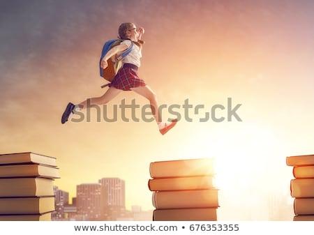 child running on books Stock photo © choreograph