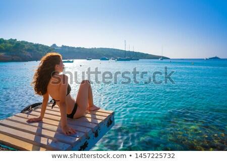 Ibiza bikini girl relaxed at Portinatx beach Stock photo © lunamarina