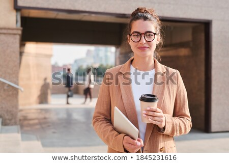 Young confident businesswoman in formalwear and eyeglasses Stock photo © pressmaster