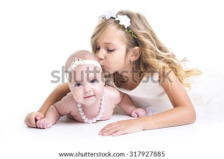 portrait of two sisters in white dresses Stock photo © Lopolo