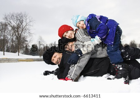 Family Lying On Top Of Each Other In Snow Stock photo © AndreyPopov