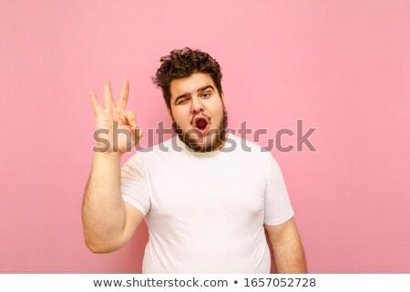 улыбаясь мальчика красный футболки вызывать Сток-фото © dolgachov