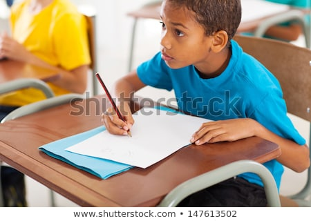Image of african american man studying with exercise book at hom Stock photo © deandrobot