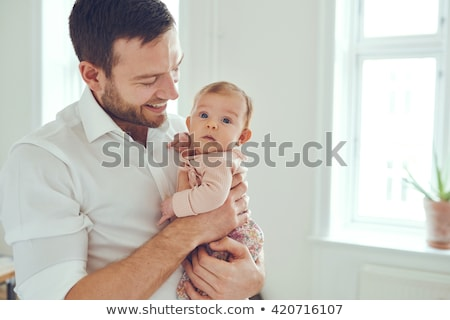 happy father holding little baby daughter at home Stock photo © dolgachov