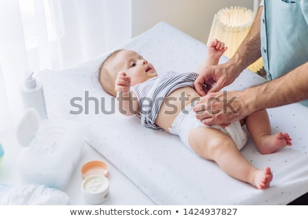 Father Care, Male with Child on Changing Table Stock photo © robuart