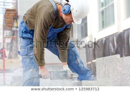 construction worker with a disc cutter stock photo © photography33