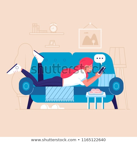 woman lying on settee with mobile phone Stock photo © photography33