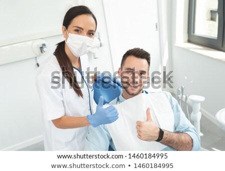 Young female technician gesturing thumbs up stock photo © wavebreak_media