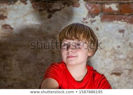 Fiú barna szemek néz vidám fiú portré fiatal Stock fotó © meinzahn